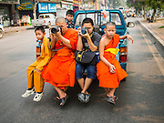 "05 APRIL 2015 - CHIANG MAI, CHIANG MAI, THAILAND: Buddhist monks ride in a the back of a pickup truck in the parade during the second day of the three day long Poi Song Long Festival in Chiang Mai. The Poi Sang Long Festival (also called Poy Sang Long) is an ordination ceremony for Tai (also and commonly called Shan, though they prefer Tai) boys in the Shan State of Myanmar (Burma) and in Shan communities in western Thailand. Most Tai boys go into the monastery as novice monks at some point between the ages of seven and fourteen. This year seven boys were ordained at the Poi Sang Long ceremony at Wat Pa Pao in Chiang Mai. Poy Song Long is Tai (Shan) for ""Festival of the Jewel (or Crystal) Sons.    PHOTO BY JACK KURTZ"