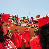 051914  Adron Gardner/Independent<br /> <br /> Lobos line up for University of New Mexico graduation at Red Rock Park Monday.