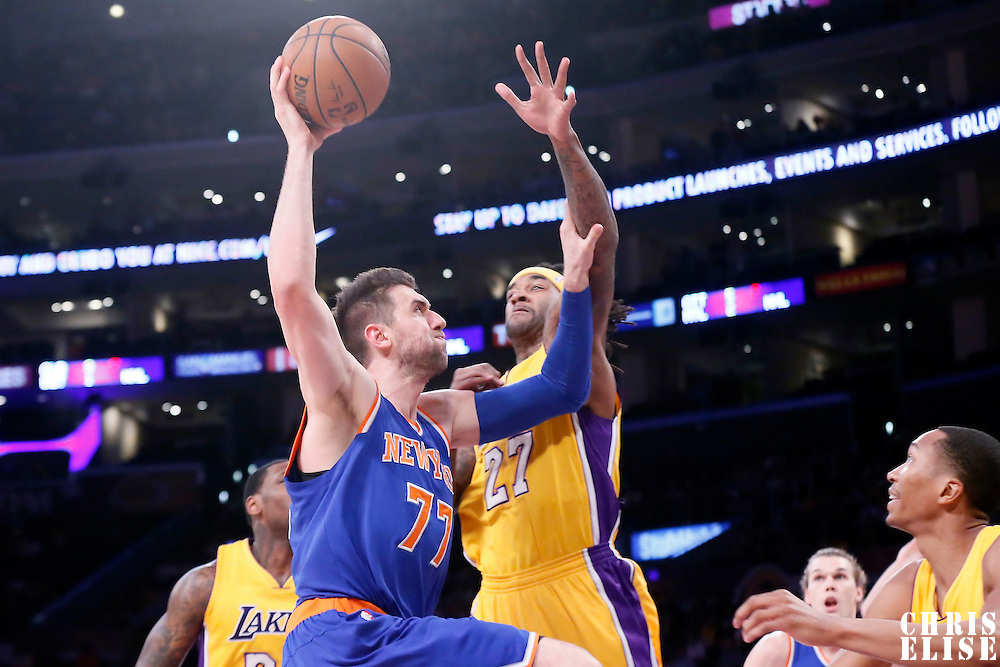 12 March 2015: New York Knicks center Andrea Bargnani (77) goes for the dunk over Los Angeles Lakers center Jordan Hill (27) during the New York Knicks 101-94 victory over the Los Angeles Lakers, at the Staples Center, Los Angeles, California, USA.