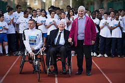 © London News Pictures. 26/02/2014. London, UK. L to R DAVID IER, Paralympic wheelchair athlete, SIR ROGER BANNISTER, the first man to run a sub-four minute mile, and DIANNE CHARLES (formerly Dianne Leather) the first woman to run a sub-five minute mile, at Paddington Recreation ground in London to launch the 2014 Bupa Westminster Mile in May 2014, which will officially celebrate the 60th anniversary. The track at Paddington Recreation ground was where Sir Roger Bannister trained for the record attempt. Photo credit: Ben Cawthra/LNP