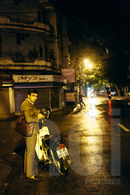 Caucasian male out at night in a street of Hanoi, Vietnam, Southeast Asia