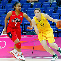 09 August 2012: Australia Belinda Snell drives past USA Maya Moore during 86-73 Team USA victory over Team Australia, during the women's basketball semi-finals, at the 02 Arena, in London, Great Britain.