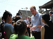 XISHUANGBANNA, CHINA - MARCH 04: (CHINA OUT) <br /> <br /> The Duke Of Cambridge Visits Yunnan's Xishuangbanna<br /> <br /> Prince William, Duke of Cambridge talks with villagers during his visit Dai Autonomous Prefecture of Xishuangbanna/Sipsongpanna on March 4, 2015 in Xishuangbanna, Yunnan province of China. The Duke of Cambridge is on a four-day visit to China. He is the first senior British royal to visit China since the Queen and Prince Philip visited in 1986<br /> ©Exclusivepix Media