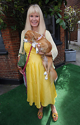 Carol Cleveland and her dog Tallulah at the unveiling of a  blue plaque dedicated to former Monty Python Graham Chapman at his local pub the Angel in Highgate, North London, Thursday, 6th September 2012  Photo by: Stephen Lock / i-Images