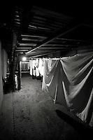 Laundry hung to dry underneath home in Roatan, Honduras. Copyright 2010 Reid McNally.