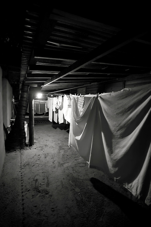 Laundry hung to dry underneath home in Roatan, Honduras. Copyright 2010 Reid McNally.