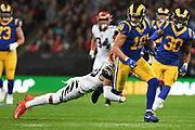 LA Rams Wide Receiver Cooper Kupp (18) is tackled by Cincinnati Bengals Defensive Back Jessie Bates III (30) during the International Series match between Los Angeles Rams and Cincinnati Bengals at Wembley Stadium, London, England on 27 October 2019.