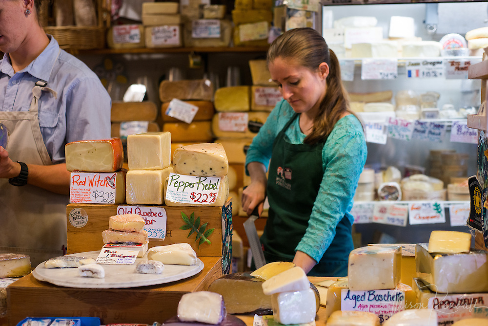 Local and imported gourmet cheese on display and for sale in the tiny and well-loved Cheese Shop of Carmel, California