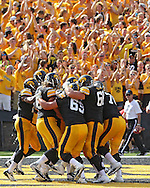 August 31 2013: The Iowa Hawkeyes celebrate after an 11 yard touchdown reception by Iowa Hawkeyes tight end C.J. Fiedorowicz (86) during the second quarter of the NCAA football game between the Northern Illinois Huskies and the Iowa Hawkeyes at Kinnick Stadium in Iowa City, Iowa on August 31, 2013. Northern Illinois defeated Iowa 30-27.