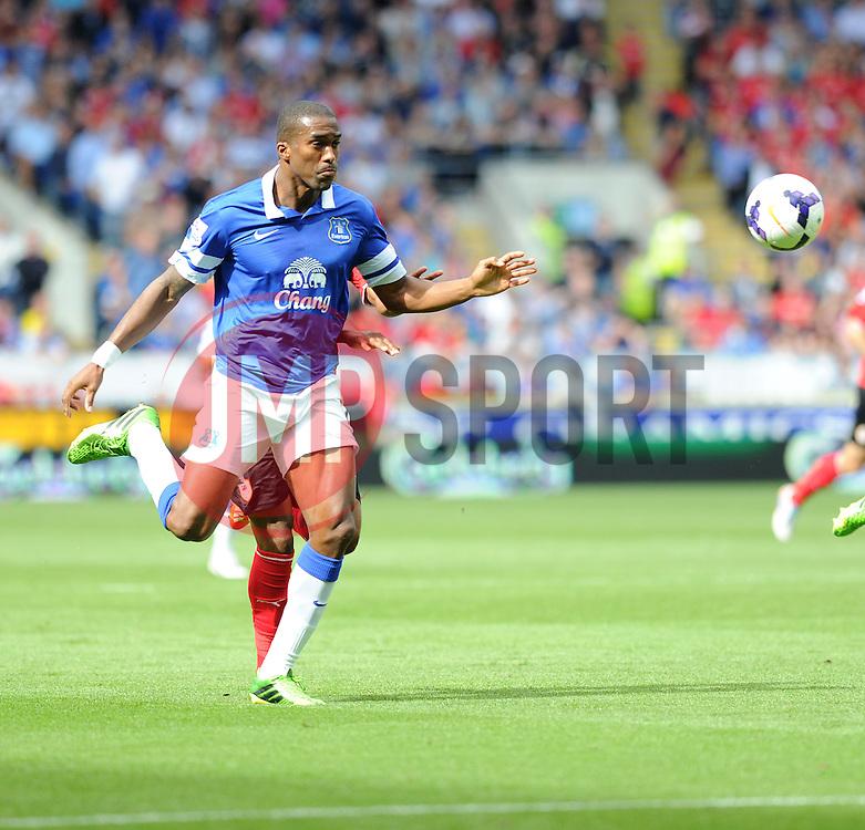 Everton's Sylvain Distin  - Photo mandatory by-line: Alex James/JMP - Tel: Mobile: 07966 386802 31/08/2013 - SPORT - FOOTBALL - Cardiff City Stadium - Cardiff - Cardiff City V Everton - Barclays Premier League