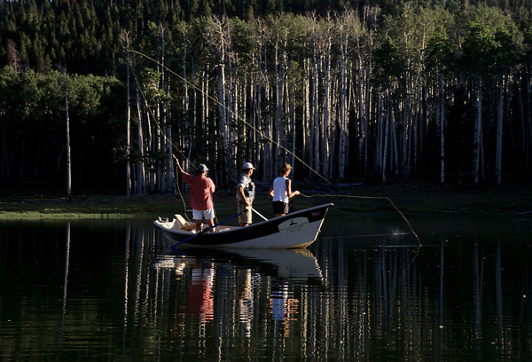 Stock photo of flyfishing from a dory on a high mountain lake in Colorado.