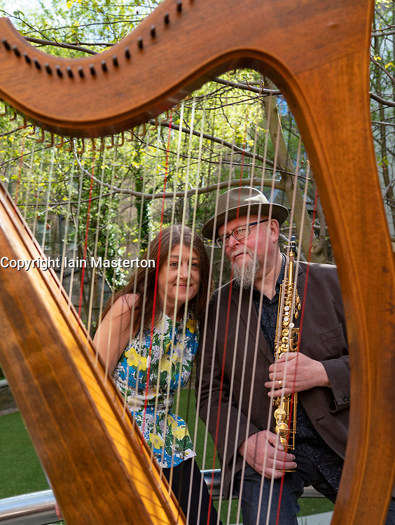 Edinburgh, Scotland, UK. 25 April, 2019. Tradfest kicks off it's 7th year  on Friday 25 April in Edinburgh. Tradfest mixes the best of traditional music, world cinema celebrating folk cultured storytelling. Pictured are  saxophonist Steve Kettley and clarsach player Savourna Stevenson in the Scottish Book Trust Garden in Edinburgh.