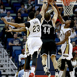 Jan 20, 2017; New Orleans, LA, USA; Brooklyn Nets guard Bojan Bogdanovic (44) has a shot blocked by New Orleans Pelicans forward Anthony Davis (23) during the first quarter of a game at the Smoothie King Center. Mandatory Credit: Derick E. Hingle-USA TODAY Sports