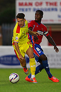 Tom Hitchcock of Milton Keynes Dons gets ahead of Abu Ogogo of Dagenham and Redbridge during the Pre Season Friendly match at the London Borough of Barking and Dagenham Stadium, London<br /> Picture by David Horn/Focus Images Ltd +44 7545 970036<br /> 22/07/2014