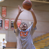 Patterson Yazzie participates in practicing passing and shooting during the Bengals basketball practice Tuesday in Gallup.
