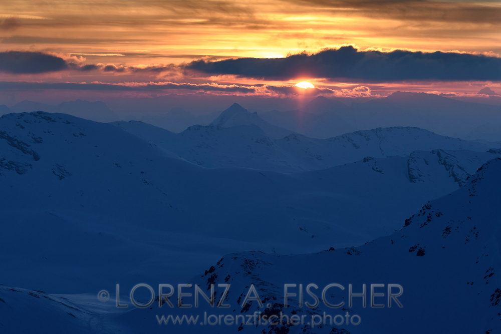 Looking towards the sunset and the Pizzo Groppera from the Piz Turba, Grisons, Switzerland