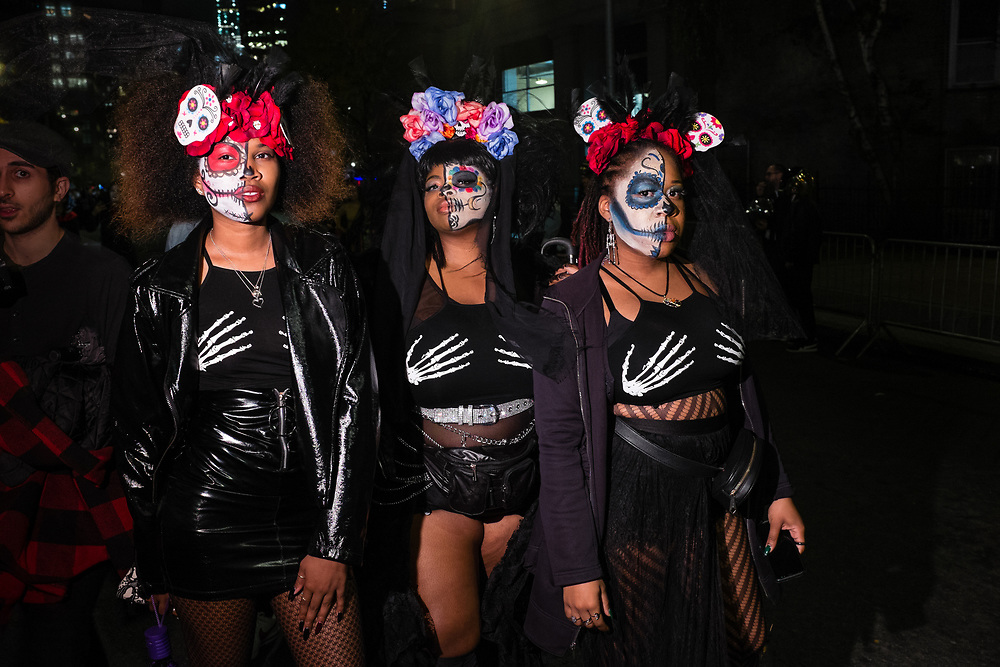 New York, NY - 31 October 2019. the annual Greenwich Village Halloween Parade along Manhattan's 6th Avenue. Three women dressed as calavera catrinas.