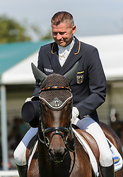 Land Rover Burghley Horse Trials. <br /> Andreas Dibowski and FRH BUTTS LEON during the Dressage phase, Burghley House, Stamford, UK, Thursday, 5th September 2013. Picture by Nico Morgan / i-Images.