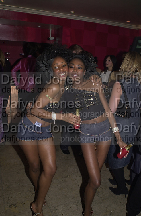 Lauretta and Shalonne lee. Glamour magazine launch party. Red Cube. 6 March 2001. © Copyright Photograph by Dafydd Jones 66 Stockwell Park Rd. London SW9 0DA Tel 020 7733 0108 www.dafjones.com