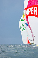 Camper and Groupama leaving the upwind mark under spinnaker at the in-port race during the 2011-2012 Volvo Ocean Race Miami stopover.