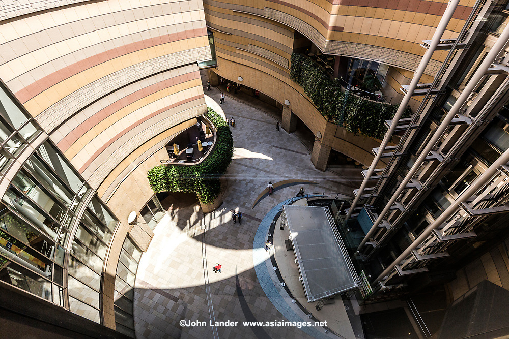 """Lacking green space in central Osaka, the upper layers of Namba Parks - a vast shopping complex - have been turned into a topsy-turvy rooftop garden. An innovative and curvaceous """"canyon"""" cuts down into the lower floors giving natural light to stores downstairs."""
