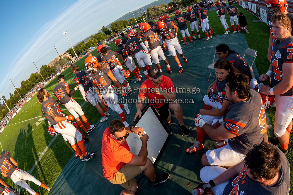 KELOWNA, BC - AUGUST 3: Coaches go over a play with the offensive line against the Kamloops Broncos at the Apple Bowl on August 3, 2019 in Kelowna, Canada. (Photo by Marissa Baecker/Shoot the Breeze)