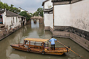Boats and gondolas along a canal at Pingjiang Road in Suzhou, China.