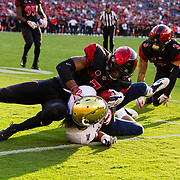 02 September 2017: San Diego State Aztecs cornerback Kameron Kelly #7 tackles UC Davis Aggies quarterback C.J. Spencer #8 in the second quarter. The Aztecs lead the Aggies 24-3 at the half at Qualcomm Stadium in San Diego, California. <br /> www.sdsuaztecphotos.com