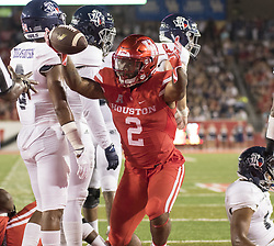 September 16, 2017 - Houston, TX, USA - Houston Cougars running back Duke Catalon (2) celebrates a touchdown during the second quarter of the college football game between the Houston Cougars and the Rice Owls at TDECU Stadium in Houston, Texas. (Credit Image: © Scott W. Coleman via ZUMA Wire)