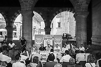 COMO, ITALY - 21 JUNE 2017: Residents of Como attend Mario Landriscina's rally,  the leading candidate for mayor of Como after the first round of voting to replace the left-leaning mayor, here at the Broletto, a medieval building next to the Cathedral in Como, Italy, on June 21st 2017. Mr Landriscina wants to close the reception centers.<br /> <br /> Residents of Como are worried that funds redirected to migrants deprived the town's handicapped of services and complained that any protest prompted accusations of racism.<br /> <br /> Throughout Italy, run-off mayoral elections on Sunday will be considered bellwethers for upcoming national elections and immigration has again emerged as a burning issue.<br /> <br /> Italy has registered more than 70,000 migrants this year, 27 percent more than it did by this time in 2016, when a record 181,000 migrants arrived. Waves of migrants continue to make the perilous, and often fatal, crossing to southern Italy from Africa, South Asia and the Middle East, seeing Italy as the gateway to Europe.<br /> <br /> While migrants spoke of their appreciation of Italy's humanitarian efforts to save them from the Mediterranean Sea, they also expressed exhaustion with the country's intricate web of permits and papers and European rules that required them to stay in the country that first documented them.