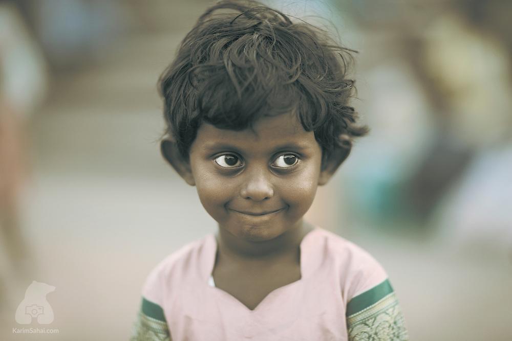 Shy toddler, Thanjavur, Tamil Nadu, India.