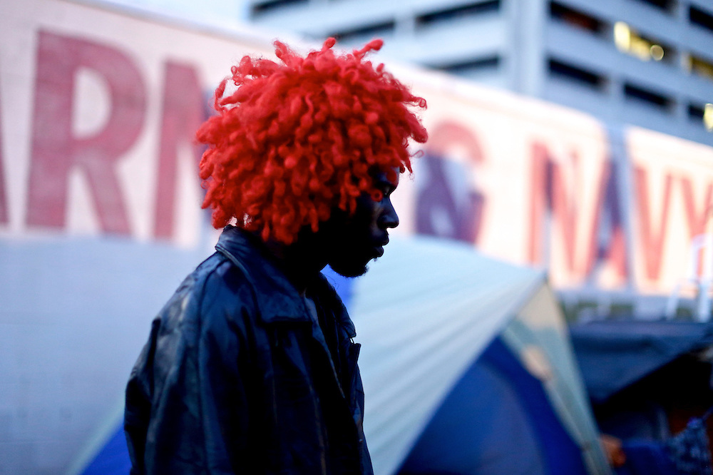 Curtis Hunt Jr. of St. Petersburg, dons a red wig at Romneyville, where many of the protestors camped out, during the 2012 Republican National Convention in Tampa, Fla. on Aug. 29, 2012.