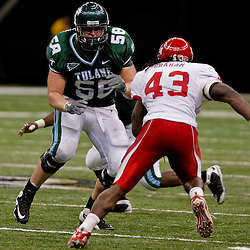 Oct 17, 2009; New Orleans, LA, USA; Tulane Green Wave offensive lineman Pete Hendrickson (58) blocks Houston Cougars defensive end Tyrell Graham (43) during a game at the Louisiana Superdome. Houston defeated Tulane 44-16.   Mandatory Credit: Derick E. Hingle-US PRESSWIRE