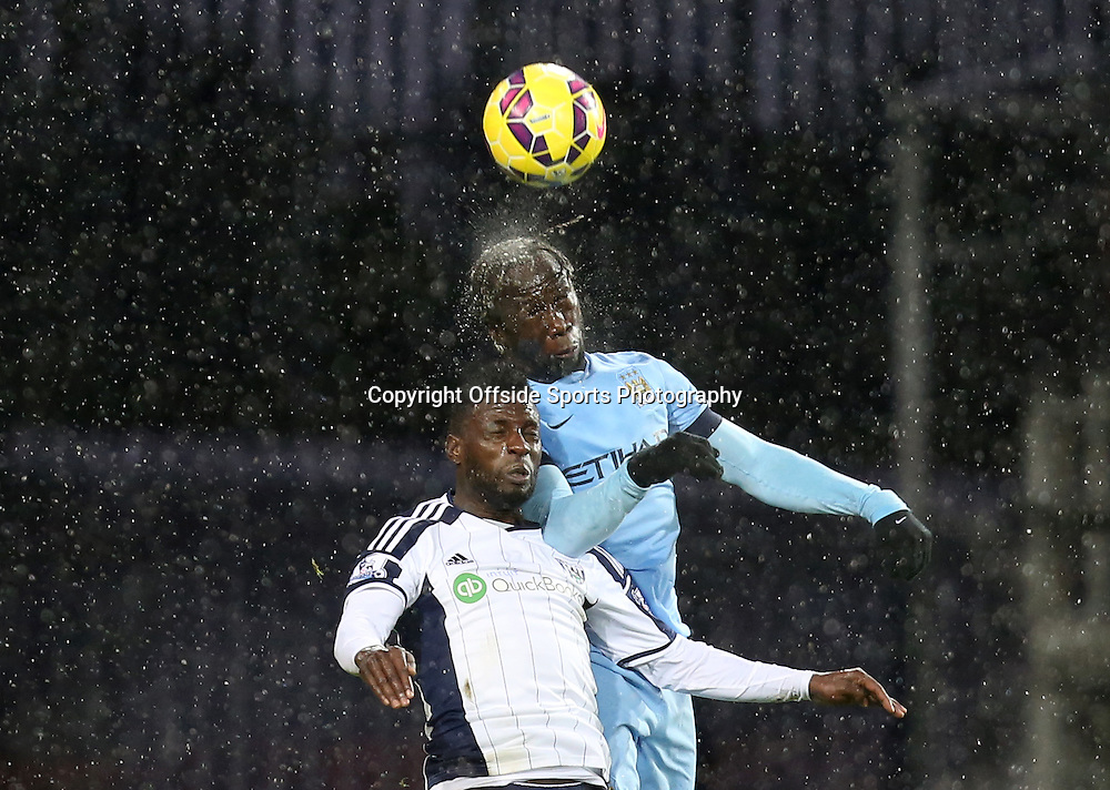 26th December 2014 - Barclays Premier League - West Bromwich Albion v Manchester City - Bacary Sagna of Manchester City wins a header from Andre Wisdom of West Bromwich Albion - Photo: Paul Roberts / Offside.