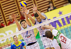 Matevz Kamnik and Klemen Cebulj of Slovenia vs Tsvetan Sokolov of Bulgaria during friendly volleyball match between National teams of Slovenia and Bulgaria on August 29, 2013 in Hoce, Slovenia. (Photo by Vid Ponikvar / Sportida.com)