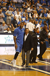 Kentucky Alum DeMarcus Cousins, left, and current head basketball coach John Calipari before the game. The Kentucky Alumni Men's Basketball team hosted the University of North Carolina Alumni in a charity game, Sunday, Sept. 13, 2015 at Rupp Arena in Lexington. <br /> <br /> Photo by Jonathan Palmer
