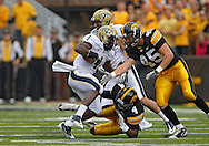 September 17, 2011: Pittsburgh Panthers running back Ray Graham (1) tries to spin away from Iowa Hawkeyes defensive back Jordan Bernstine (4) and Iowa Hawkeyes linebacker Tyler Nielsen (45) during the first half of the game between the Iowa Hawkeyes and the Pittsburgh Panthers at Kinnick Stadium in Iowa City, Iowa on Saturday, September 17, 2011. Iowa defeated Pittsburgh 31-27.