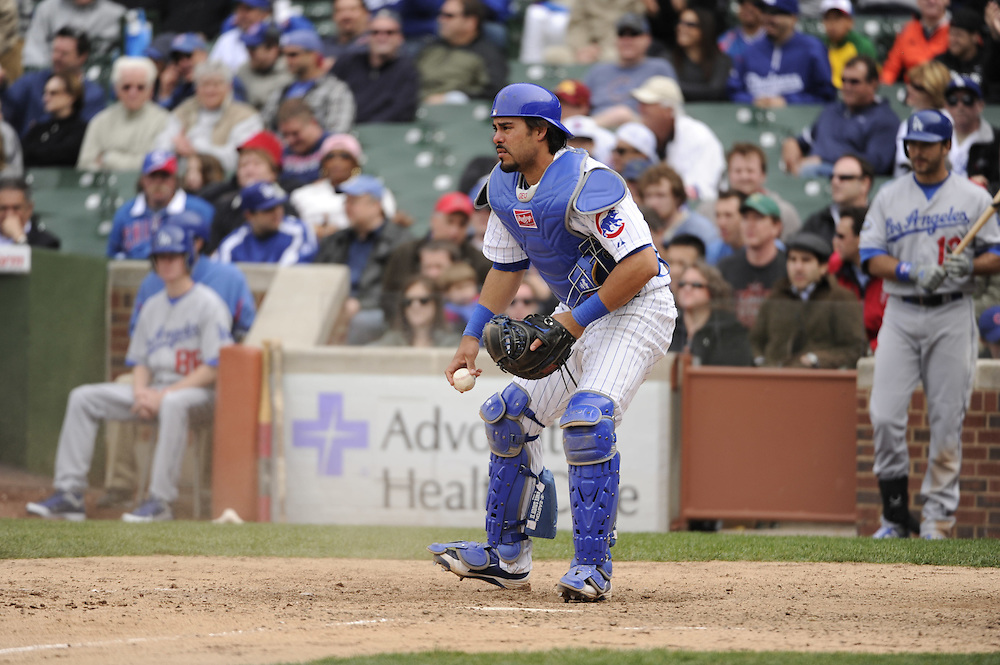 CHICAGO - MAY  04:  Geovany Soto #18 of the Chicago Cubs catches against the Los Angeles Dodgers on May 4, 2012 at Wrigley Field in Chicago, Illinois.  The Cubs defeated the Dodgers 5-4.  (Photo by Ron Vesely)   Subject:  Geovany Soto