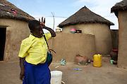 Balila leaving her home to go to school at Pope John's Catholic Junior High School, Ghana.