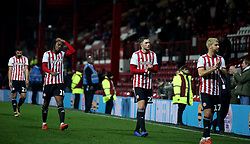(Left to right) Brentford's Yoann Barbet, Romaine Sawyers, Henrik Dalsgaard and  Emiliano Marcondes looks dejected at full time