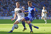 Fulham defender Calum Chambers (5) holds up Cardiff City defender Joe Bennett (3) during the Premier League match between Cardiff City and Fulham at the Cardiff City Stadium, Cardiff, Wales on 20 October 2018.