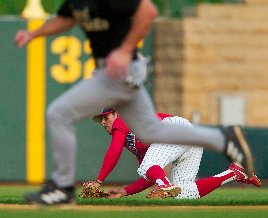 (SPORTS) Lakewood 5/13/2004  Blueclaws second baseman Omar Bramasco turns and throws from the grass after making a diving play on the edge of the outfield grass at second.  He sucessfully threw the runner out at first.  Michael J. Treola Staff Photographer......MJT