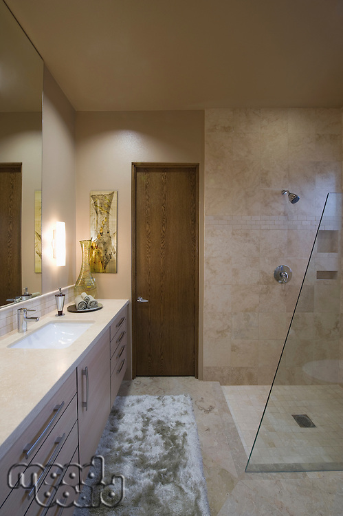 Lit bathroom with shower in Palm Springs home