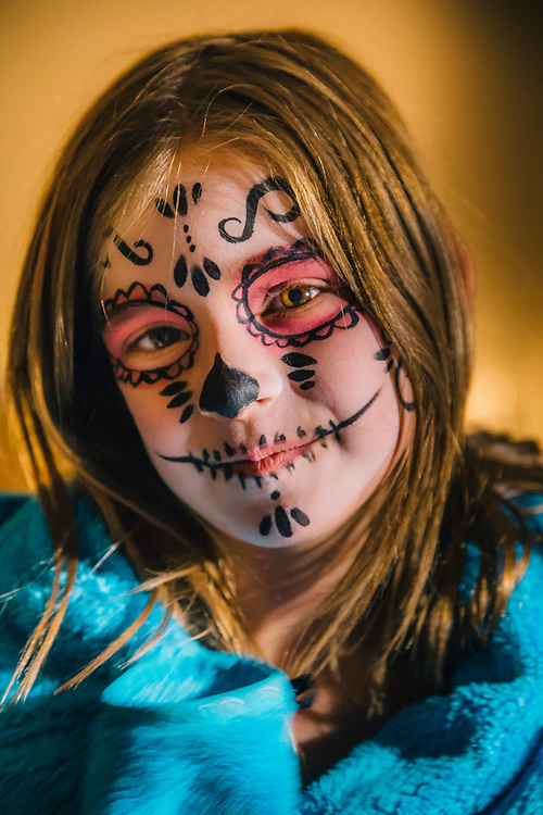 Jade Goodrich highlights the face painting/tattoo that she received during the Día de Muertos celebration in Jackson, Wyoming.