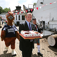 Birthday Celebrations at The Famous Grouse Experience in Crieff as the distillery marks the 111th year of the brand 'Grouse Whisky' and the 5th year of The Famous Grouse Experience centre. General Manager Jeremy Speirs carries the birthday cake flanked by Gilbert Grouse and piped in by David Boyle.<br /> <br /> Picture by Graeme Hart.<br /> Copyright Perthshire Picture Agency<br /> Tel: 01738 623350  Mobile: 07990 594431