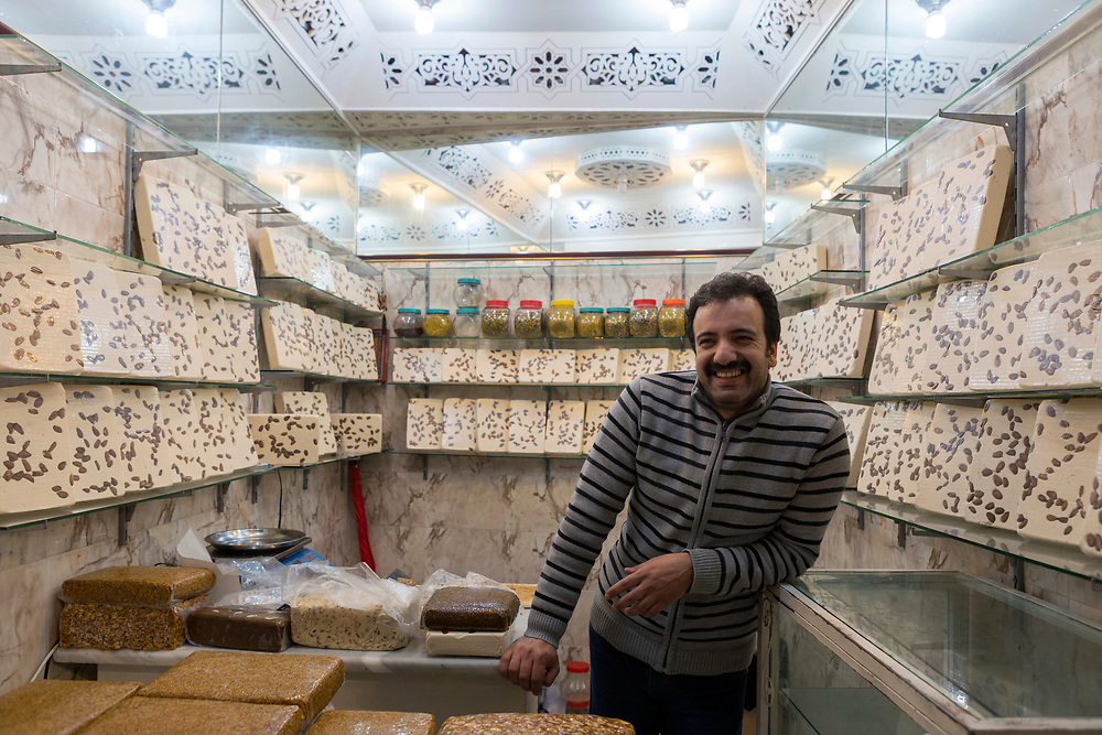 FEZ, MOROCCO, 1ST FEBRUARY 2018 - Nougat seller at a market stall in the old Fez Medina, Middle Atlas Mountains, Morocco.