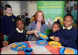Eastenders actress Patsy Palmer serves breakfast to school children  on a visit to Laycock Primary School in Islington, London, to take part in London's Biggest Breakfast. Thursday, 22nd May 2014. Picture by Andrew Parsons / i-Images.<br /> <br /> Patsy Palmer goes back to school to host a hearty breakfast in support of 'London's Biggest Breakfast Campaign' <br /> <br /> The EastEnders Actress is having breakfast with children from Laycock Primary School Breakfast Club in Islington to raise money for London youth charity, the Mayor's Fund for London.