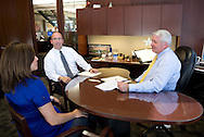 Wendy Nielsen (from left), Assistant Vice President of Medial Relations, James Klein, Senior Vice President, and Larry Helling, President of Cedar Rapids Bank & Trust, talk in Helling's office in Cedar Rapids, Iowa on Monday, August 20, 2012. .