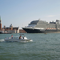 VENICE, ITALY - MAY 02:  Cruise ship Nieuw Amesterdam sails in front of Isola di S Giorgio on May 2, 2011 in Venice, Italy. Giant cruise ships passing through St Mark Basin and Giudecca Canal are causing continue controversy for the possible damages to the lagoon and Venice buildings