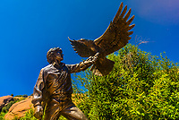 "A bronze sculpture of musician John Denver holding an eagle, titled ""Spirit"" by Sue DiCicco, Colorado Music Hall of Fame, Red Rocks Trading Post, Red Rocks Park and Amphitheatre, Morrison (near Denver), Colorado USA."